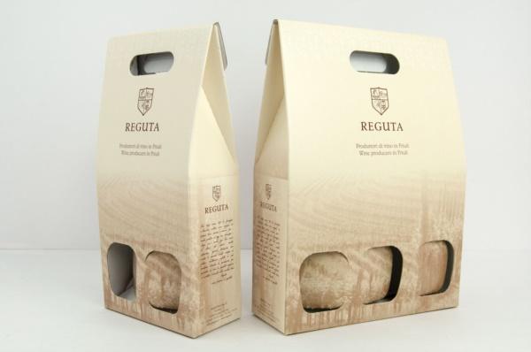 Confezioni per bottiglie con oro in lamina su nero| Packaging - Espositori - Bag in Box
